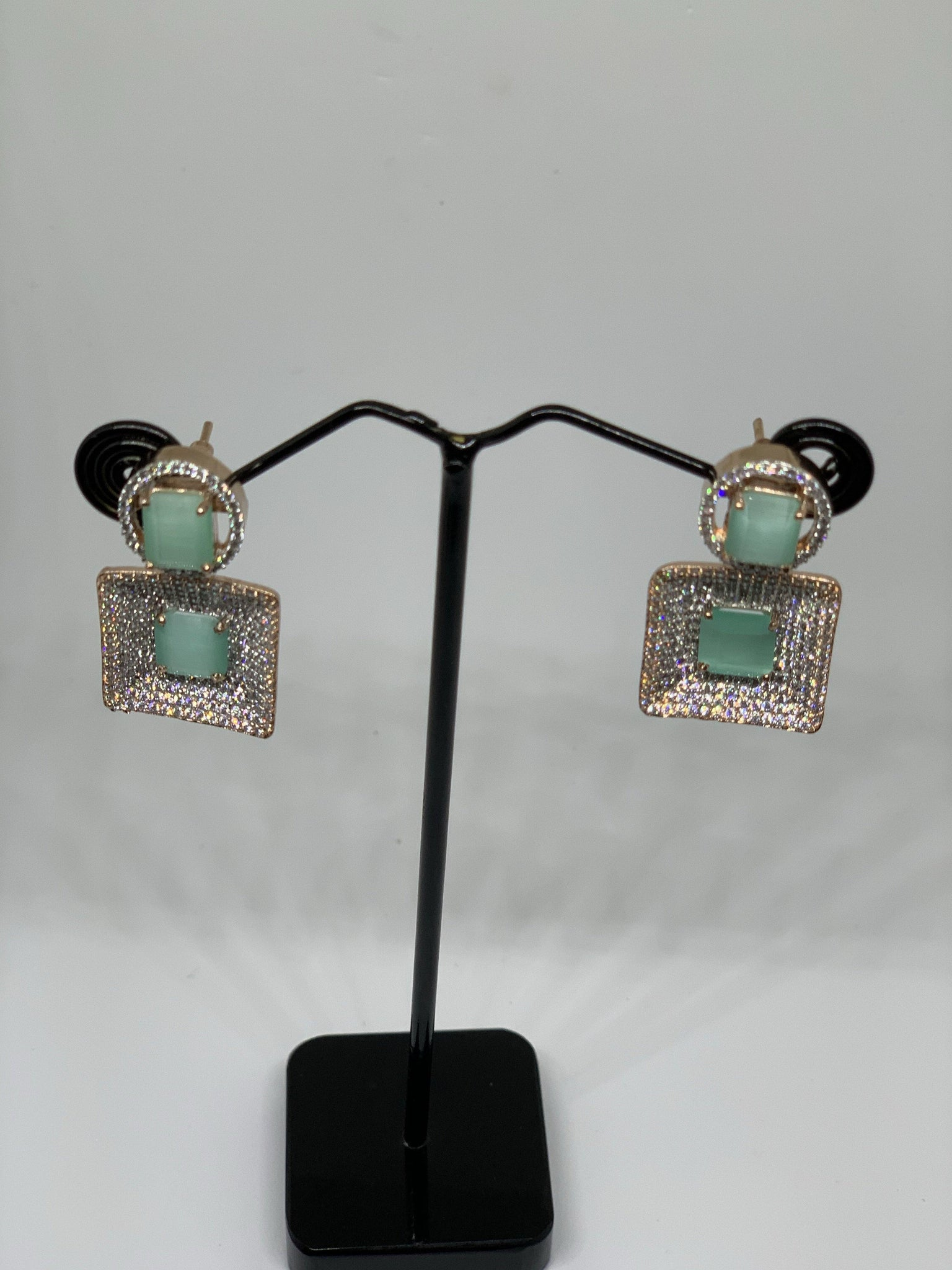 Square stone studded dangle earrings