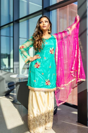Parakeet green with floral embroidered top and golden gharara suit