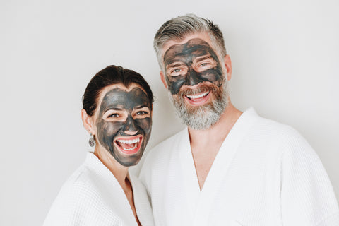 Couple using blackhead removal face masks