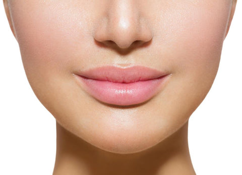 up-close of woman's mouth after lip mask