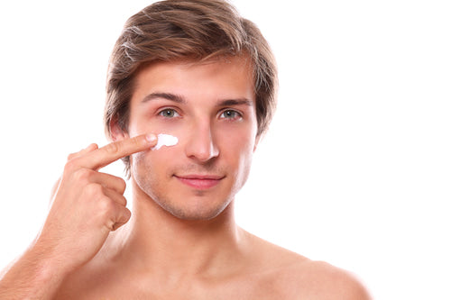 Man applying moisturizer as part of his men's face care