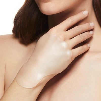 woman wearing SiO HandLift patches to reduce age spots on your hands