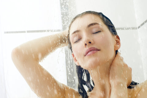 woman in shower with window in background