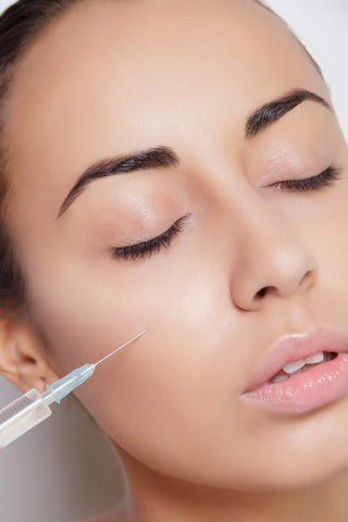 Woman receiving fillers for wrinkles