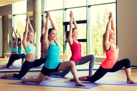 happy women in yoga class