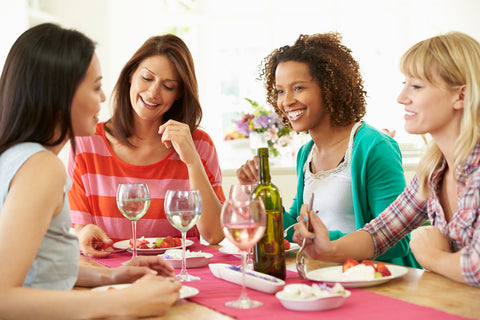 group of women chatting over wine