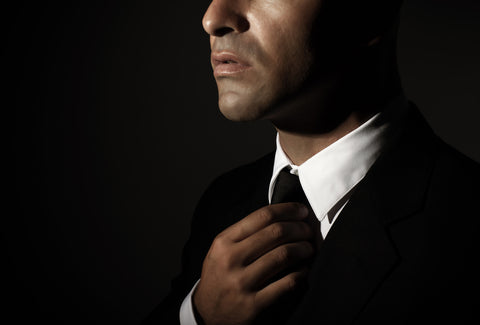 dark image of man in suit