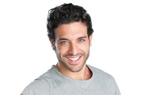head shot of smiling man in gray shirt
