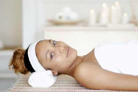 woman waiting for her microcurrent facial to begin at a spa