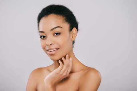 woman enjoying her newly rejuvenated skin after a microneedling treatment