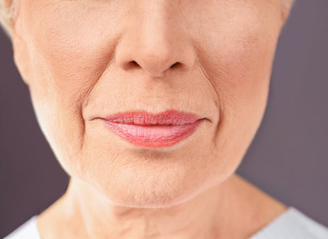 close up of woman's nose and mouth area showing nose wrinkles
