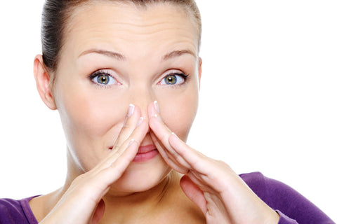 woman doing facial exercises to prevent nose wrinkles