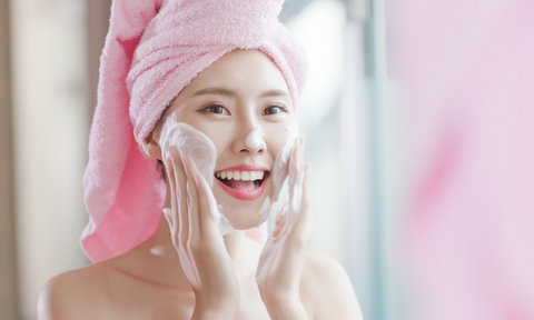 Woman exfoliating face