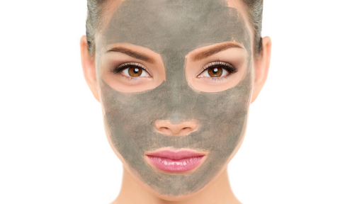 Woman applying clay face mask