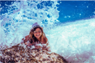 woman splashed by wave