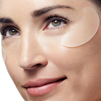 woman wearing SiO Beauty patches to help with sunken eyes