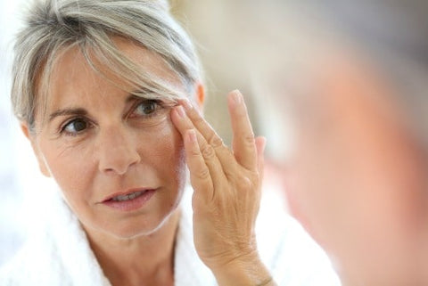 woman applying eye cream to get rid of sunken eyes
