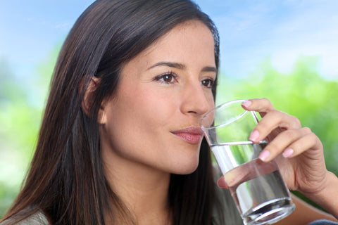 Woman drinking water to prevent forehead wrinkles