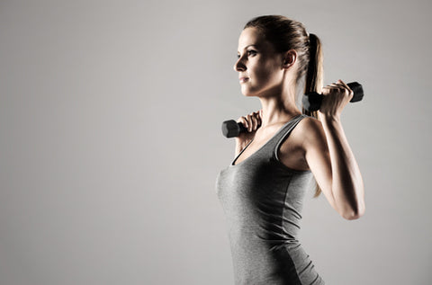 side view of woman using hand weights to get rid of wrinkly elbows