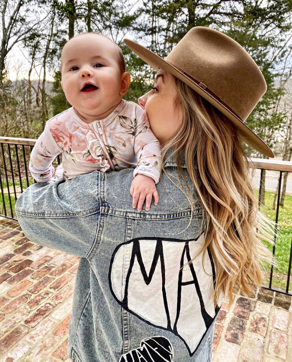 GYMNAST SHAWN JOHNSON EAST IN HER 'MAMA' JACKET