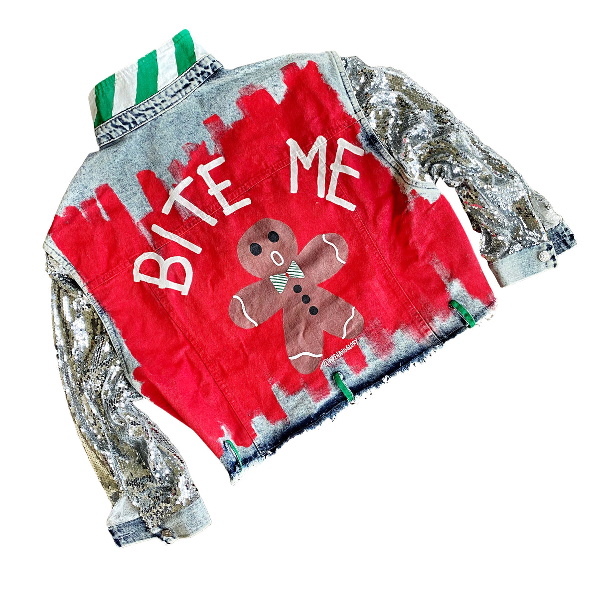 Blue denim jacket with sequined sleeves. Red base painted throughout, with gingerbread man on back, and BITE ME in semi circle above it. Signed @wrenandglory.