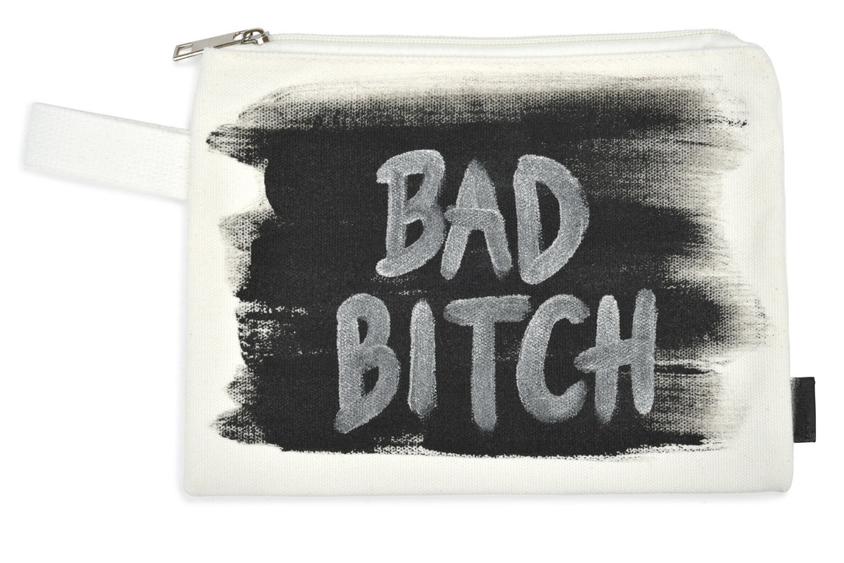 White denim zippered pouch Hand painted 'Bad Bitch' on one side, crossbones on the other.