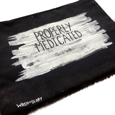 'MEDICATED' PAINTED POUCH