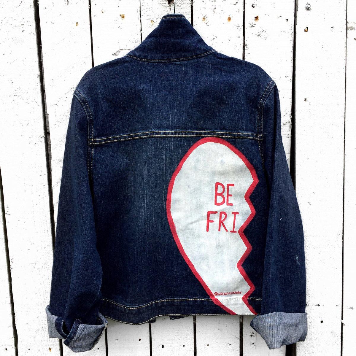Medium blue denim wash. Broken hearts, one on each jacket, with BEST FRIENDS split up between the 2 jackets. White stripes on diagonal on fronts, pockets painted white. Signed @wrenandglory.
