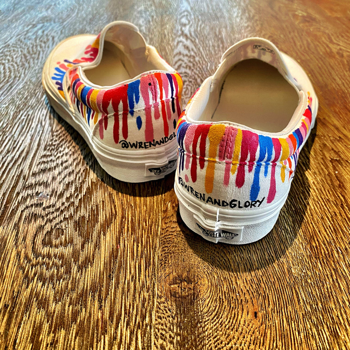 Painted on White Vans Classic Slip-On Assorted colors painted in heavy drip effect across entire sneaker. Signed @wrenandglory.