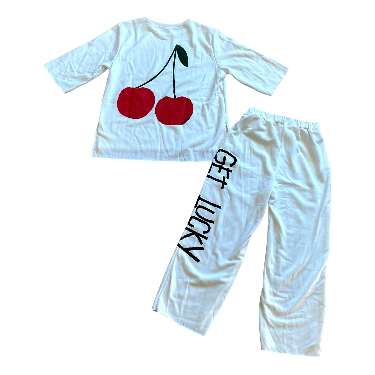 The perfect white sweatshirt & sweatpant loungewear set. Large cherries painted on back of sweatshirt, with GET LUCKY painted in black down leg of pant. Signed @wrenandglory on both top and bottom.