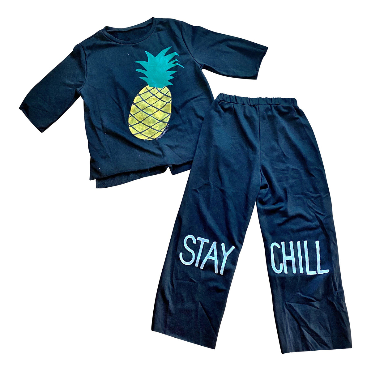 The perfect sweatshirt & sweatpant loungewear set. Large pineapple painted on front of sweatshirt, with STAY CHILL painted on the bottom half of each leg, in white Signed @wrenandglory on both top and bottom.