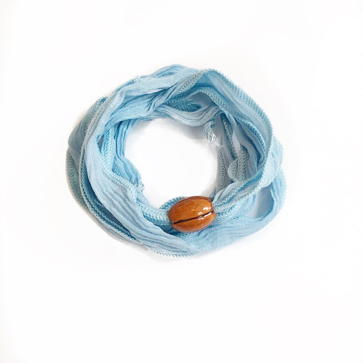 Light blue silk wrap with football charm Silk wrap hand made, and hand dyed.