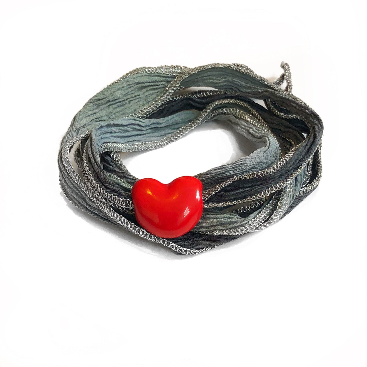 Gray ombre metallic silk wrap with heart charm. Silk wrap hand made, and hand dyed.