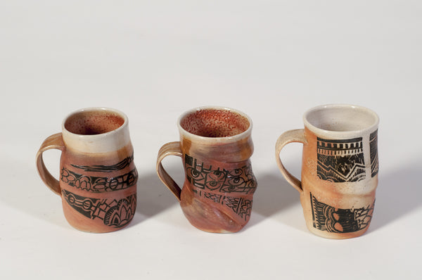 carved wood fired mugs