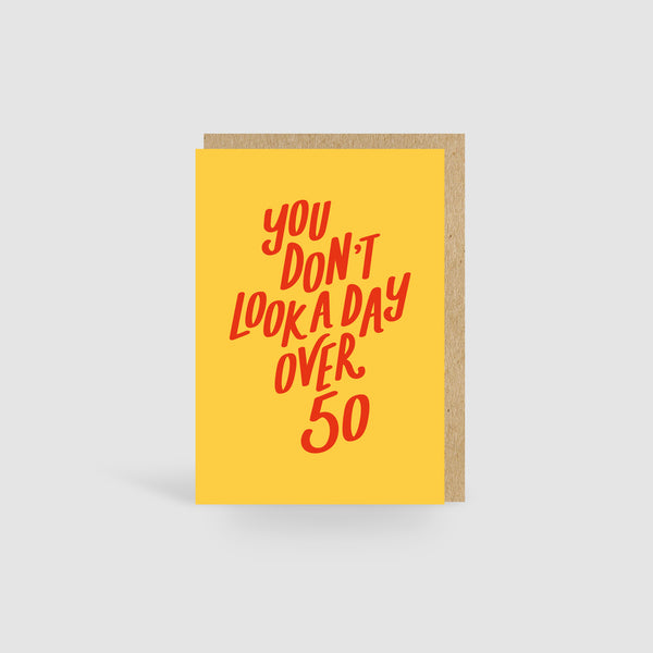 You Don't Look A Day Over 50! Lilac Birthday Card