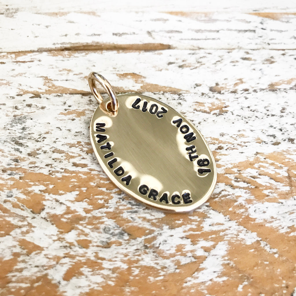 HAND STAMPED GOLD OVAL PENDANT
