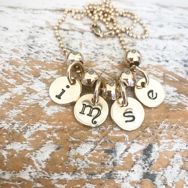 HAND STAMPED GOLD TOKEN PENDANTS