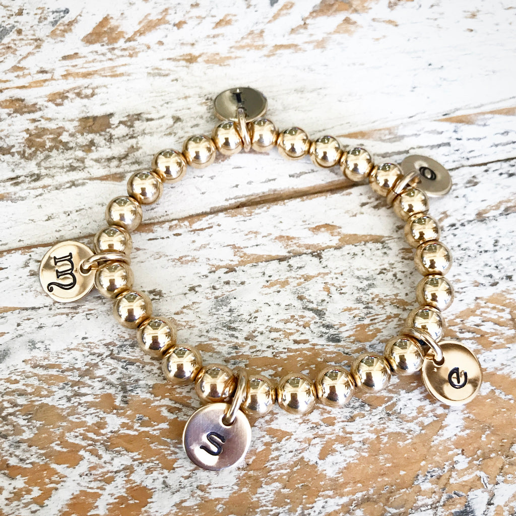 HAND STAMPED GOLD CIRCLE OF LOVE BEADED BRACELET