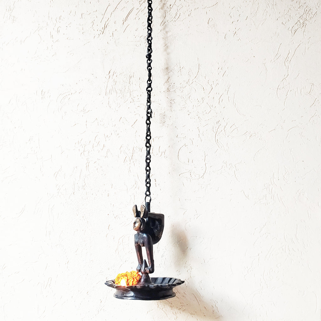 Brass Thooku Vilakku Hanging Lamp With Figurine Of Woman. Length 107 cm x Dia 18 cm