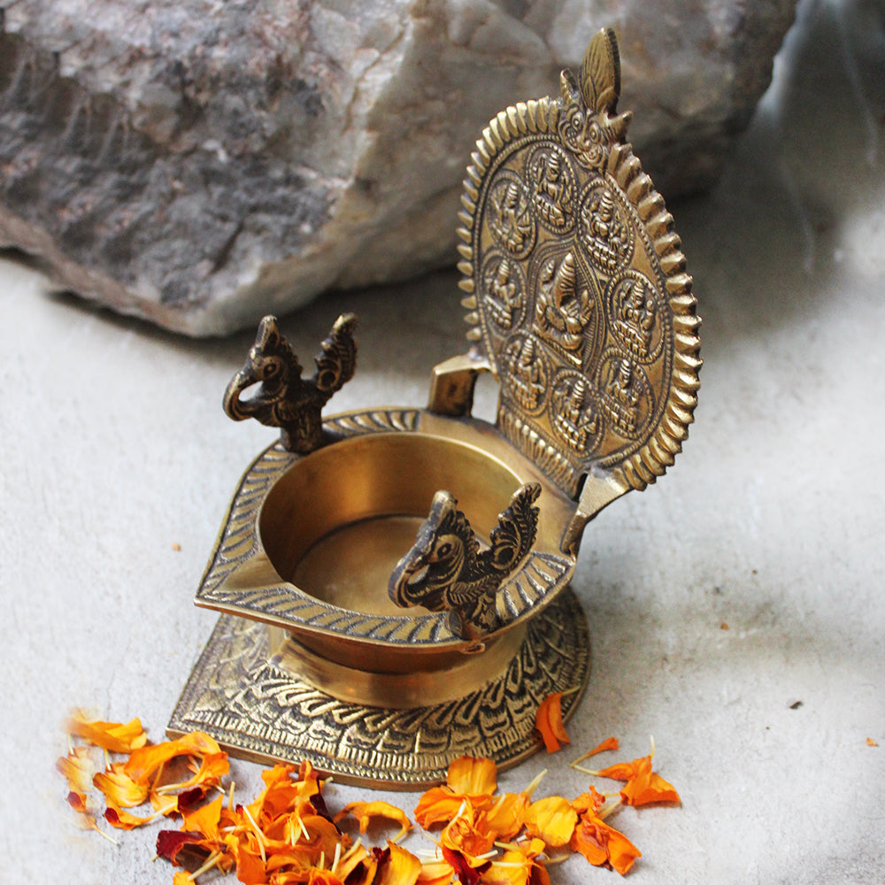Traditional Ashtalakshmi Vilakku - Divine Brass Oil Lamp With Peacocks. Ht 18 cm x W 12 cm x L 14 cm