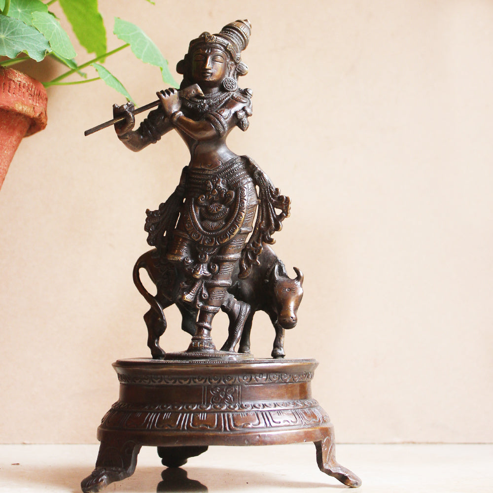 Brass Sculpture of Lord Krishna With The Sacred Cow In Copper & Gold Patina - Ht 25 cm