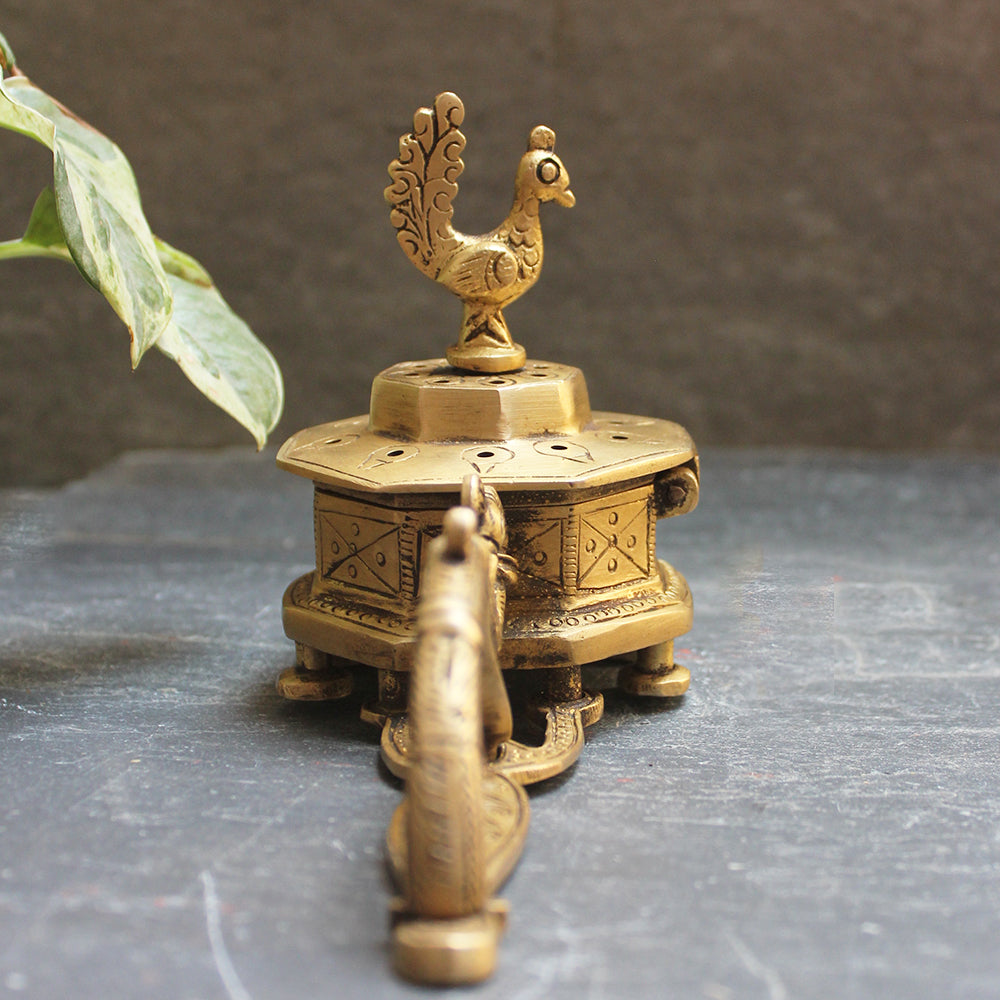 Octagonal Brass Incense Burner With A Peacock Handle & The Mythical Hamsa - L 20 cm x W 8 cm x H 6 cm