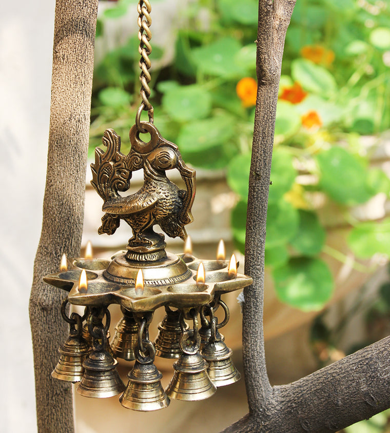 Handcrafted Exquisite Peacock Oil Lamp with 9 Diyas & 9 Bells On A Chain- Length 55 cm x Dia 13 cm - theindianweave