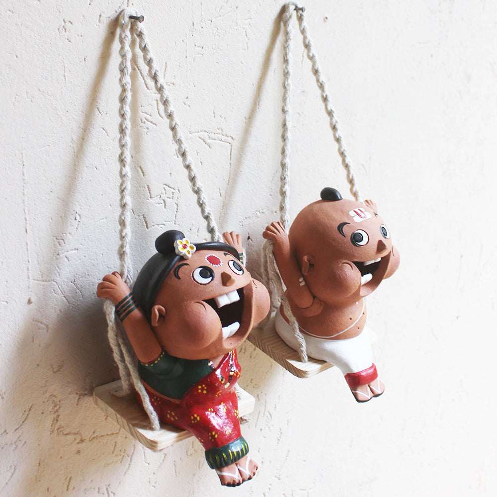Captivating Terracotta Fun Figures Of Indian Priest & His Wife On Swings - Ht 35 cm x W 13 cm x D 15 cm