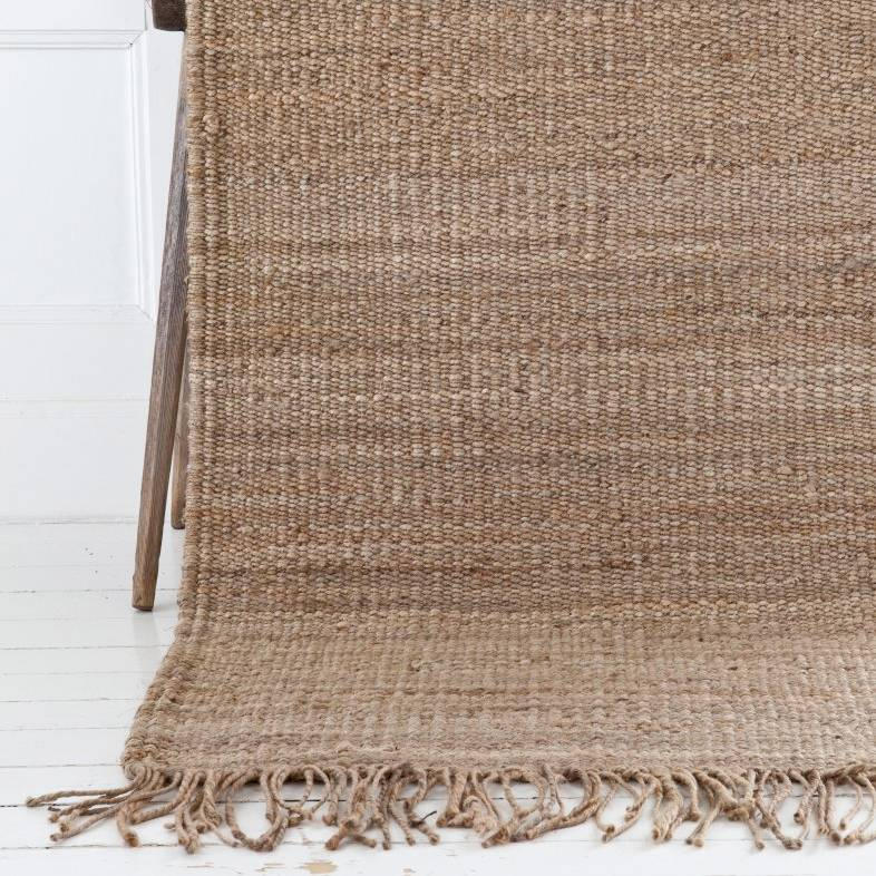 Handwoven natural hemp rug By Mölle with fringes.
