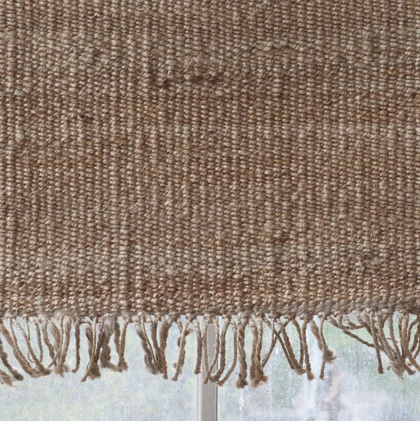 Handwoven hemp rug By Mölle with fringes.