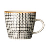 carla square pattern mug black with orange rim