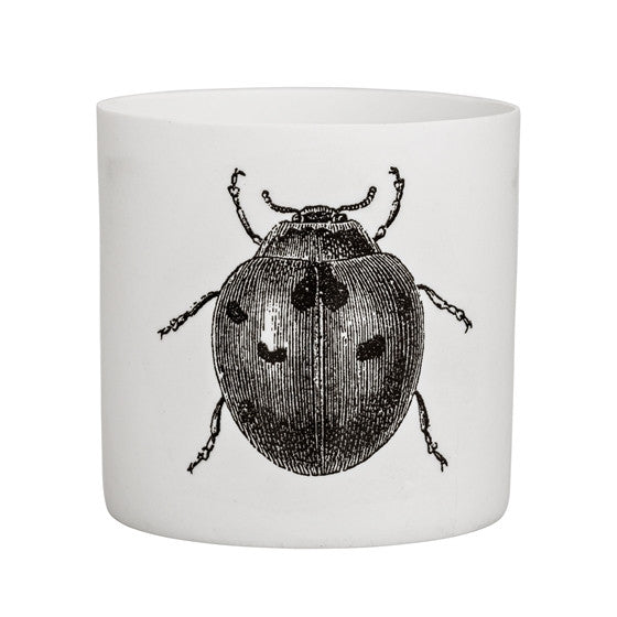 black and white lady bug votive