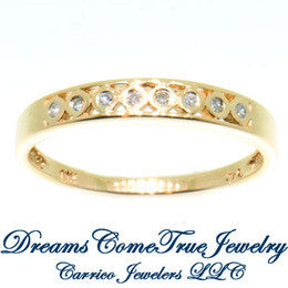 0.16 CTW 8 Diamond 10K Yellow Gold Band