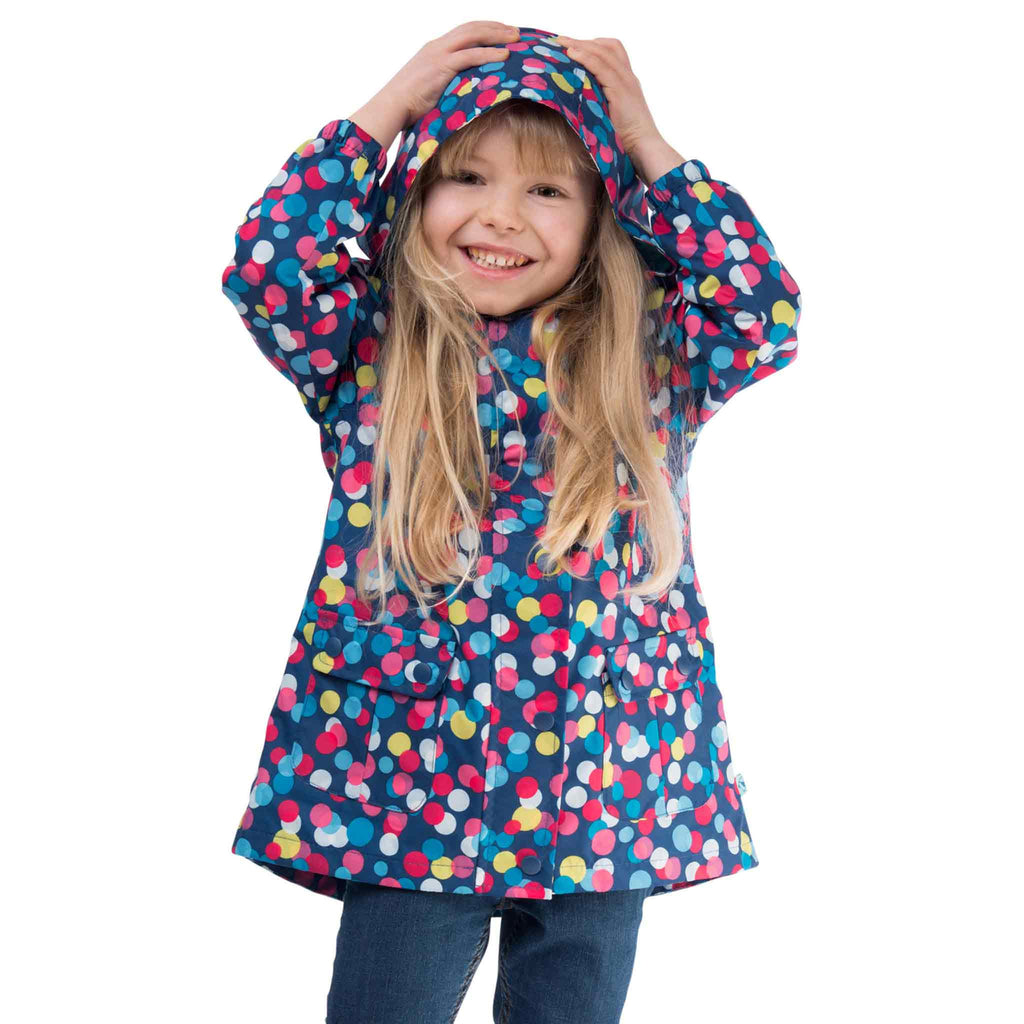 Carrie Girls Waterproof Hooded Jacket, in Washed Navy Polka Dot, Modelled Front View | Lighthouse